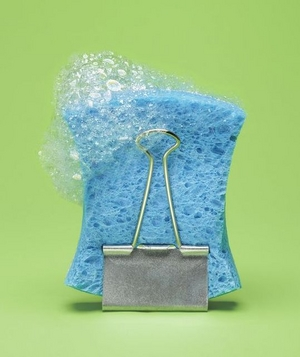 Sponge being held by a binder clip