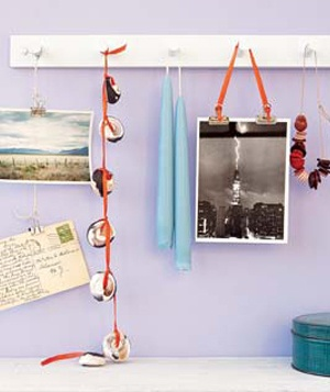 Photos displayed on a coat rack