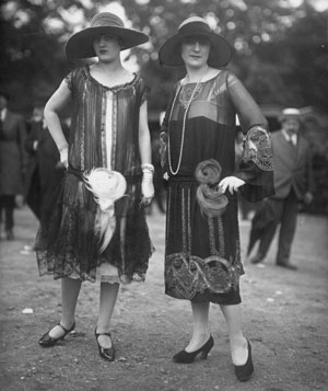 Two women wearing black dresses
