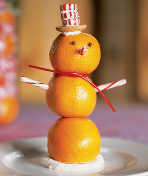 Snowman made out of clementines and peppermint candies