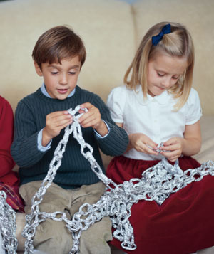 Children making holiday garland