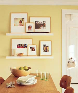 table with photos on shelves