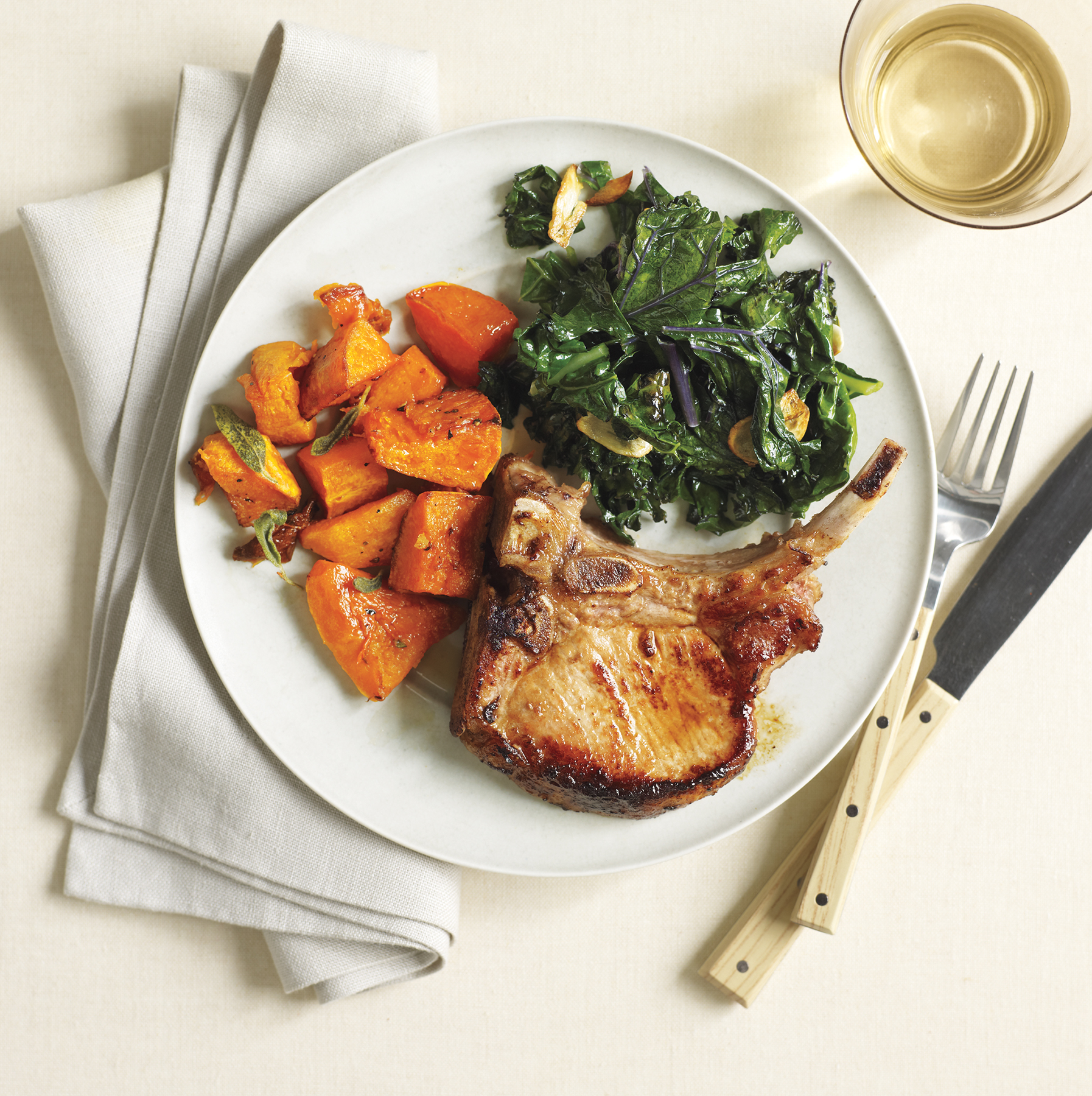 Roasted Pork Chops and Butternut Squash With Kale, one of our healthy dinner recipes.