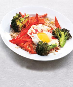Asian rice and vegetable bowl and chili sauce