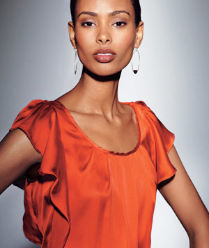 Model in orange blouse