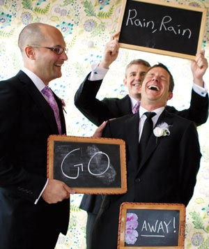Wedding guests holding chalkboards