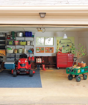 Organized Gardeners' Garage with lawn mower