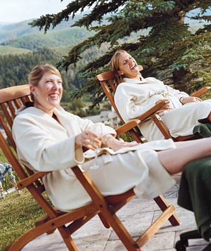 Two women relaxing in robes at the Cordillera Lodge Spa