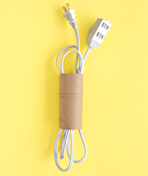 Extension cord stored in toilet paper roll