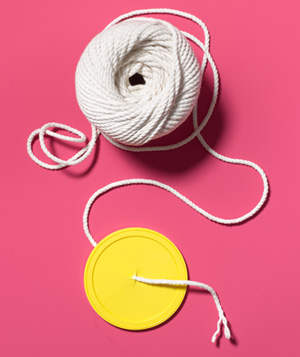 Coffee Can Lid as Twine Dispenser