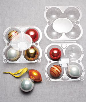 Ornaments stored in plastic apple containers