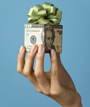 Woman Holding Gift Wrapped in US Currency