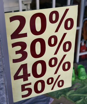 Percentage mark-down sign in store window