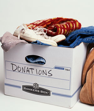 Donation box with used clothes and purse