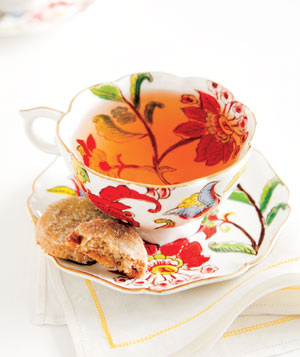 Flower tea cup with cookies on a white napkin