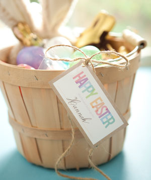 Easter basket with eggs inside and Happy Easter tag