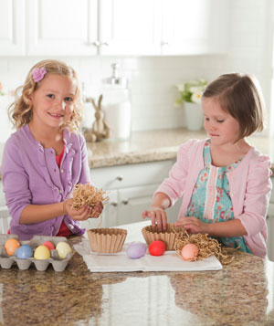 2 Girls making natural Easter egg nests