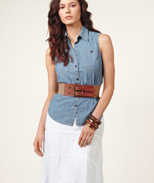 Model wearing long white Dakota skirt, blue Ralph Lauren shirt, elastic PVC Express belt and bangles