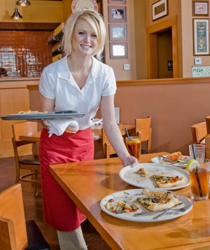 Waitress working in restaurant
