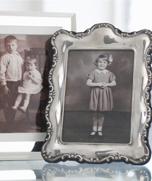 Two framed vintage family photographs of children