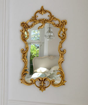 Gold baroque mirror on a wall