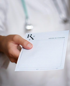 Doctor holding Rx prescription