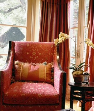 Ornate sitting room with antique red chair