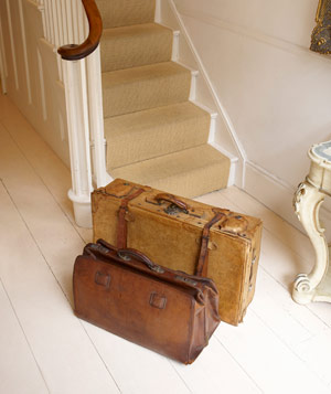 Luggage at bottom of stairs