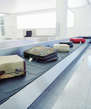 Various suitcases on airport baggage carousel