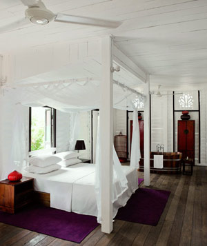 Elegant suite with four post canopy bed in resort