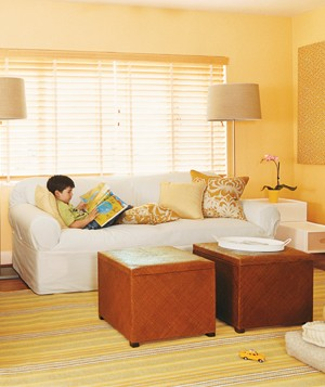 Yellow room with kid on a couch