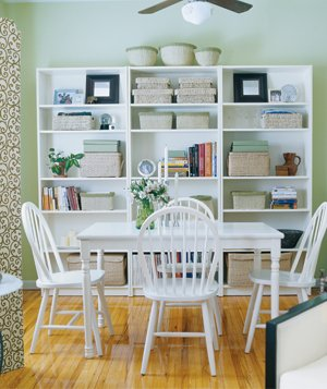 White kitchen table and green walls