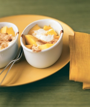 A concoction of mango and vanilla yogurt is browned in ramekins and served warm.