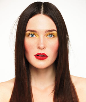 Model with red lips and yellow eyes