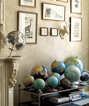 Cluster Bulky Playthings, Like Globes or Vintage Toys, on a Low, Wide Platform