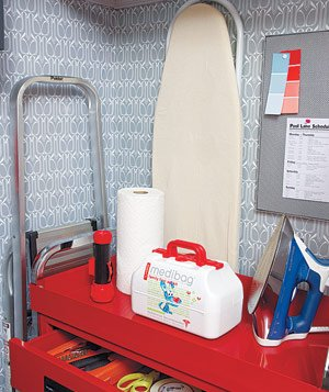 Red Mechanics Utility Cart, first-aid kit, iron, ironing board and flashlight in a closet