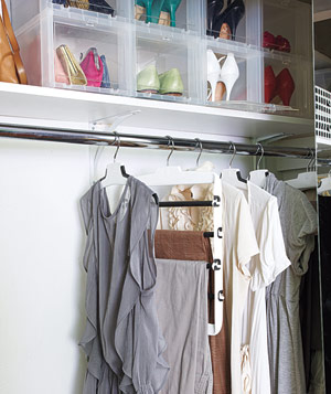 Closet with plastic shoe holders and Oxo pant hanger