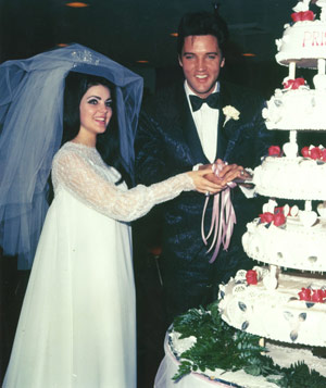 Elvis Presley & Priscilla Presley cutting their wedding cake