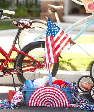 Container of Independance Day decorations, American flag and bicyle in background