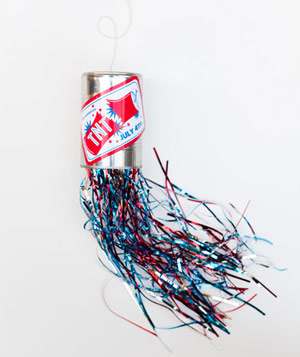 Tin can with TNT label on string with metalic strands