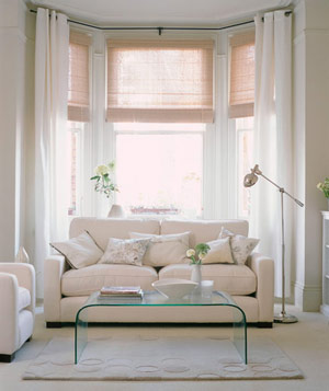 Cream Colored Living Room With Big Soft Couch Against Bay Window With Sheer  Drapes Part 61