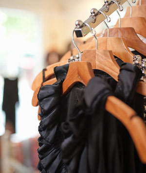 Black dresses on hangers at a boutique