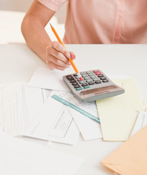Woman going over finances with calculator