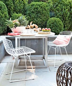 Custom aluminum-and-stone table on stone terrace