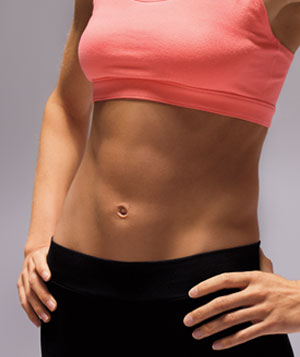 Womans stomach in workout gear