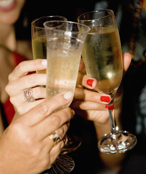 Women toasting with champagne flutes