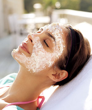 Portrait of model resting in the sun with white face masque