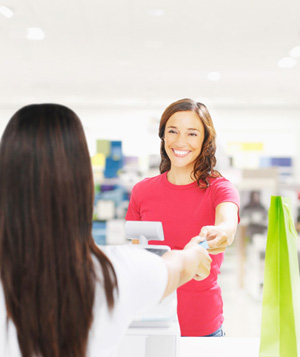 Woman checking out with credit card