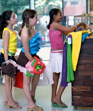 Teenage girls buying clothes