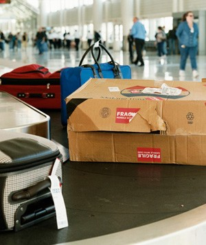 Damaged package on an airport baggage conveyor belt